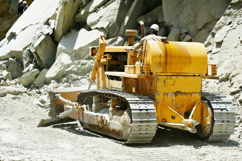 Track-type loader bulldozer excavator at road work stock photos