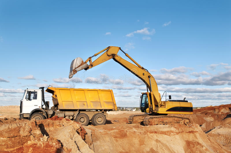 Track-type loader excavator stock photos