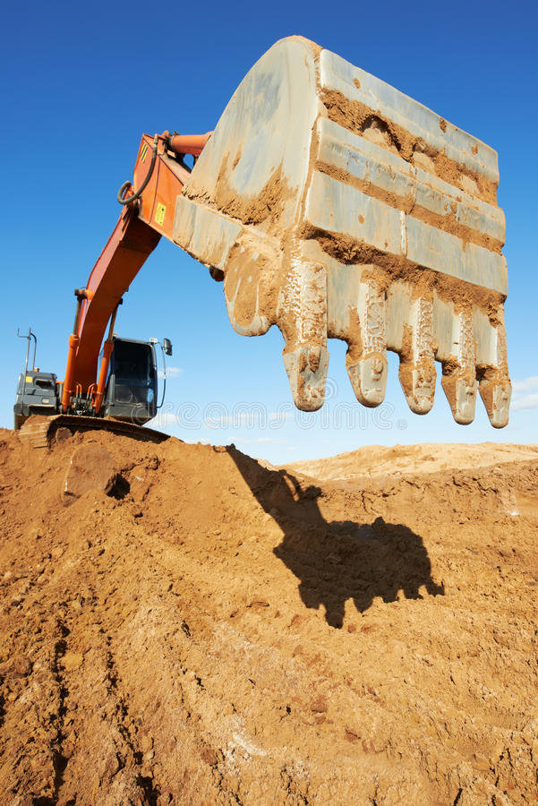Track-type loader excavator at work stock photo