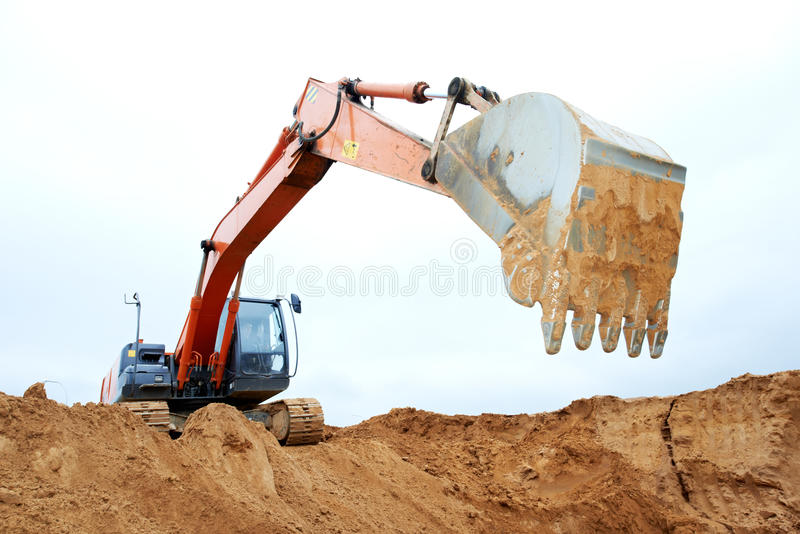 Track-type loader excavator at work royalty free stock photos