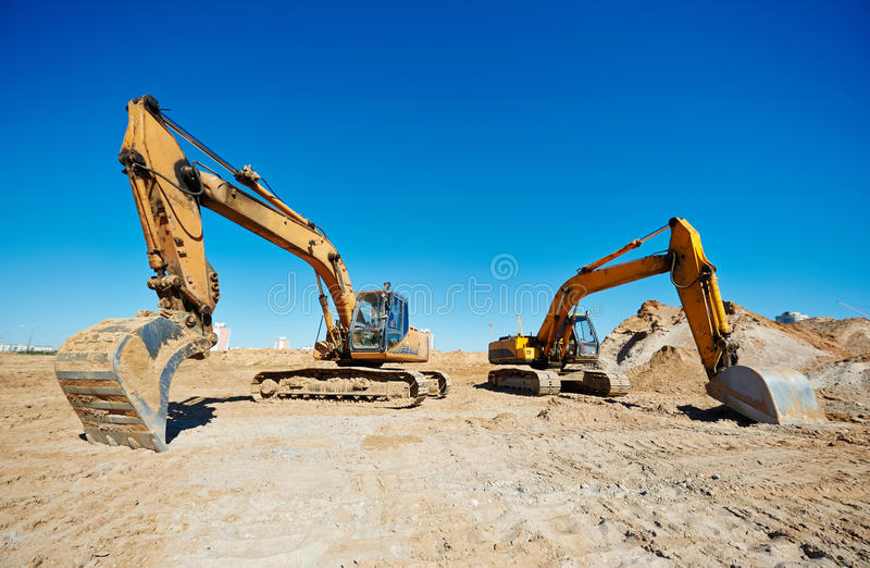 Track-type loader excavators at work stock photo