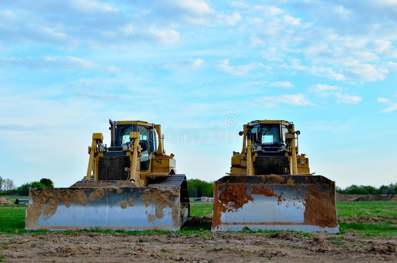 Track-Type Tractors, Bulldozer, Earth-Moving Heavy Equipment for Construction. Image stock images