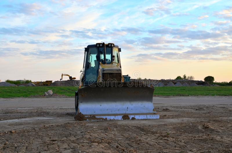 Track-Type Tractors, Bulldozer, Earth-Moving Heavy Equipment for Construction. Image stock photo