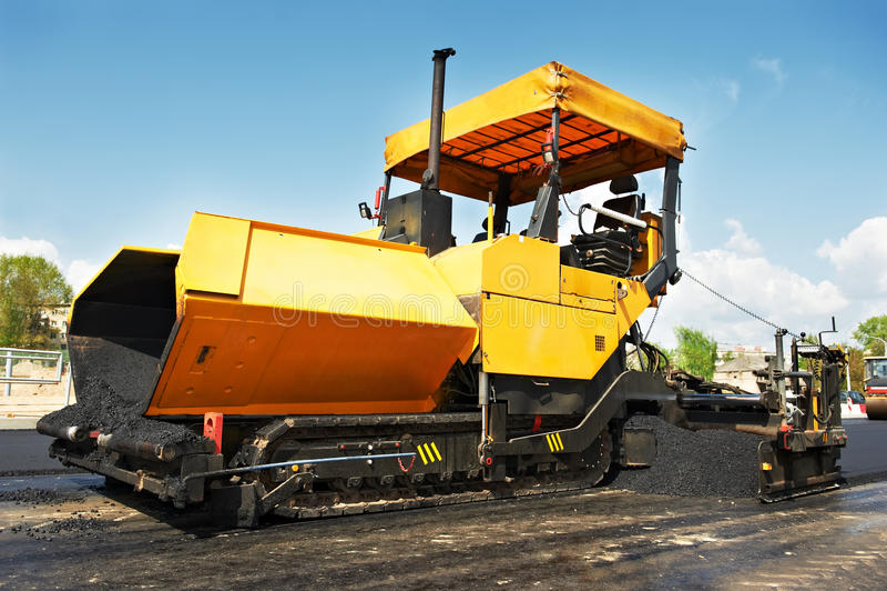 Tracked asphalt paver stock photos
