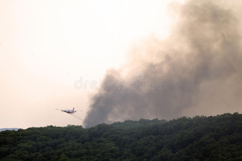 Tracker water bomber. In the sky of southern France from extinguishing a forest fire royalty free stock photography