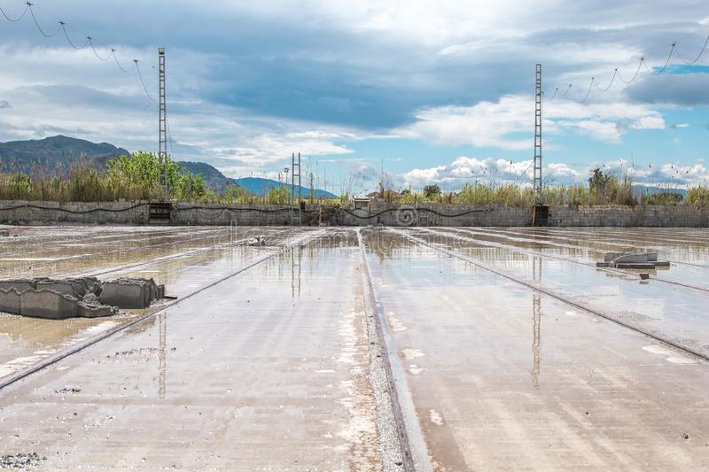 Tracks cover with puddle of rain on a factory house building stock photo