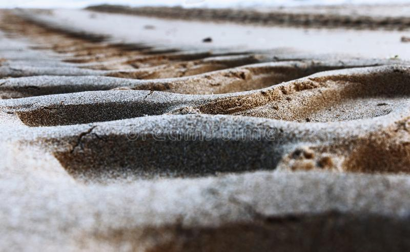 Tracks on the sand. Tire tracks on the sand , low angle view ,selective focus ,beautiful color contrast stock images