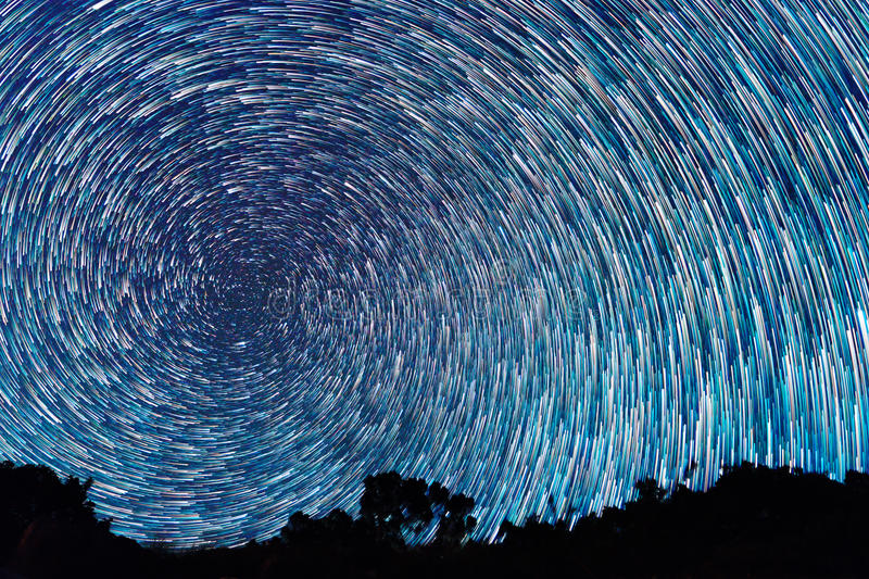 Tracks from stars in the form of spiral fading lines stock photography