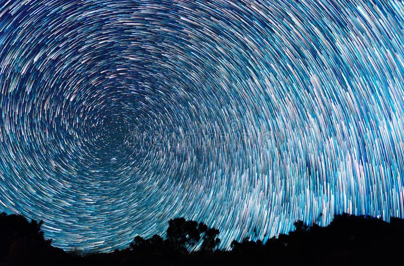 Tracks from stars in the form of spiral fading lines royalty free stock photo