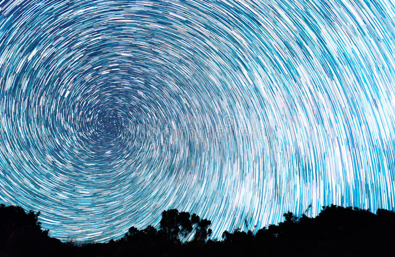 Tracks from stars in the form of spiral lines stock photography
