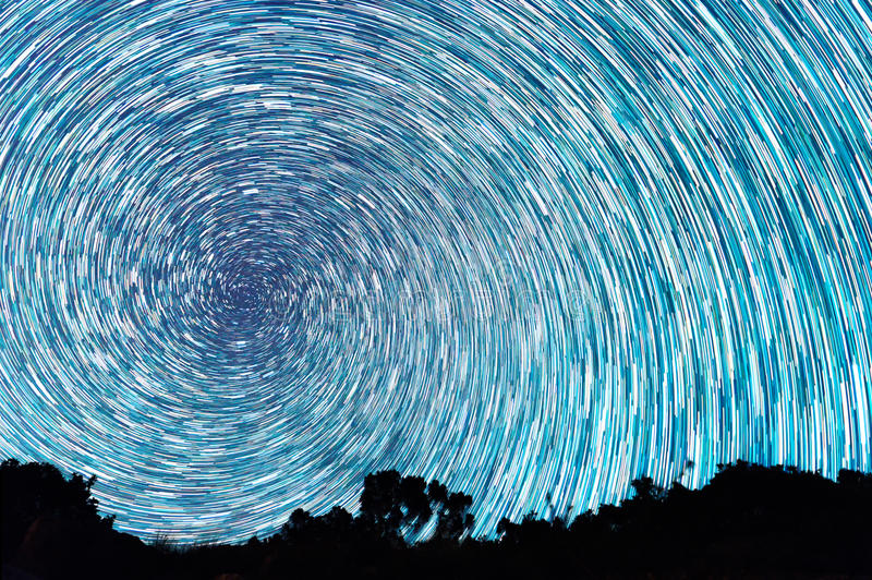 Tracks from stars in the form of spiral lines royalty free stock images