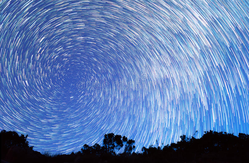 Tracks from stars in the form of spiral lines stock photos
