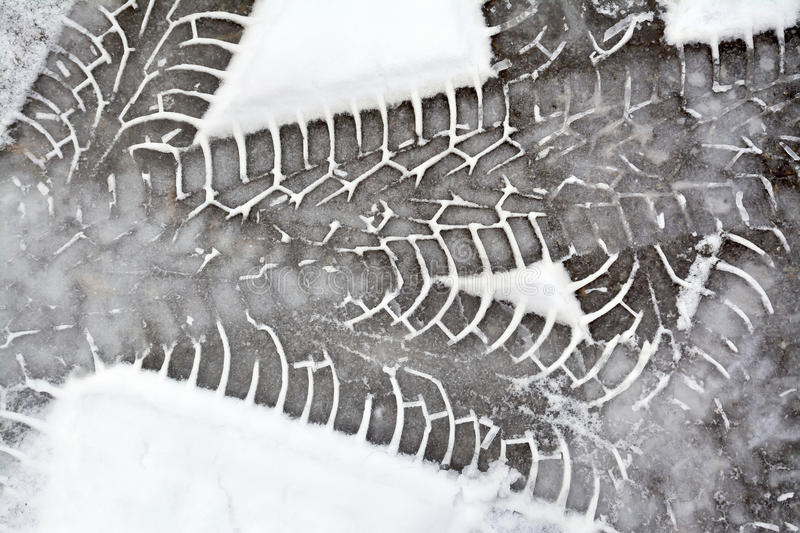 Tracks tire car in snow stock images