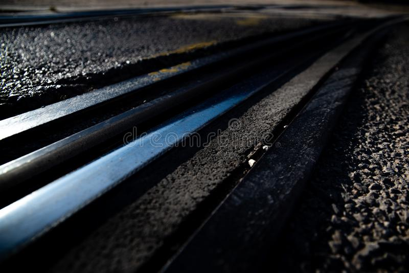 Tracks of an urban tram between the asphalt of a street.  royalty free stock photos