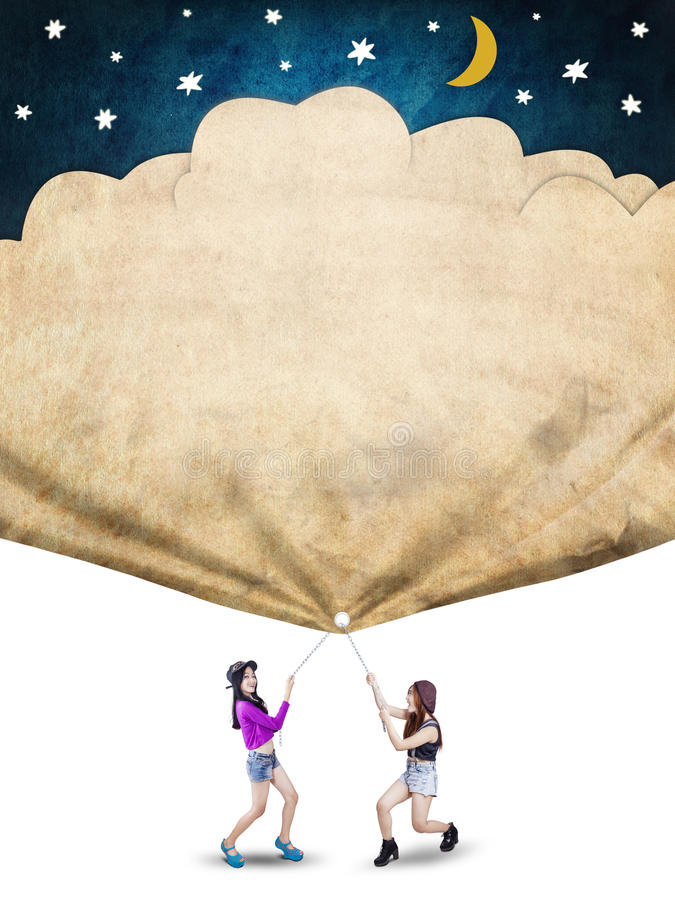Traction de deux étudiants une bannière de leurs rêves illustration stock
