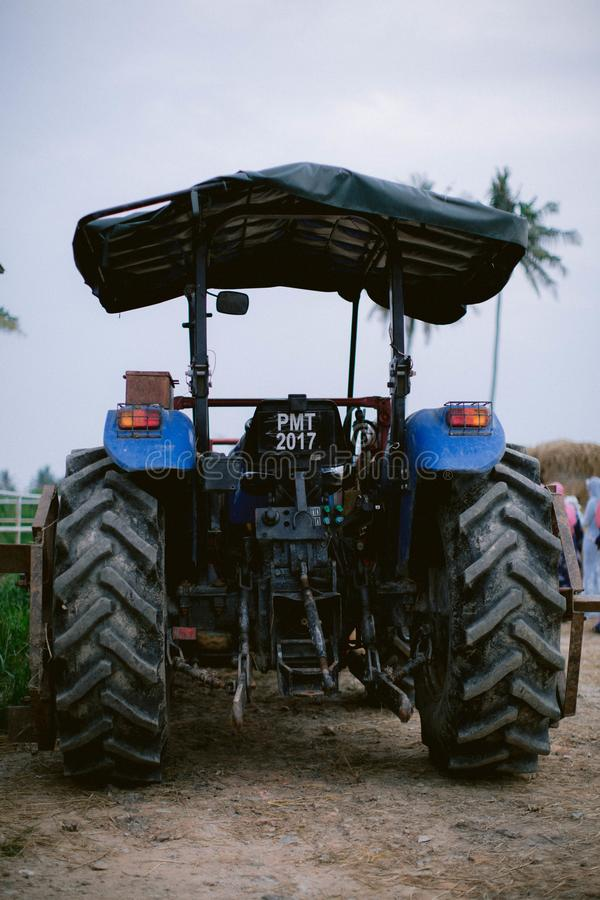 Blue tractor in the farm stock photography