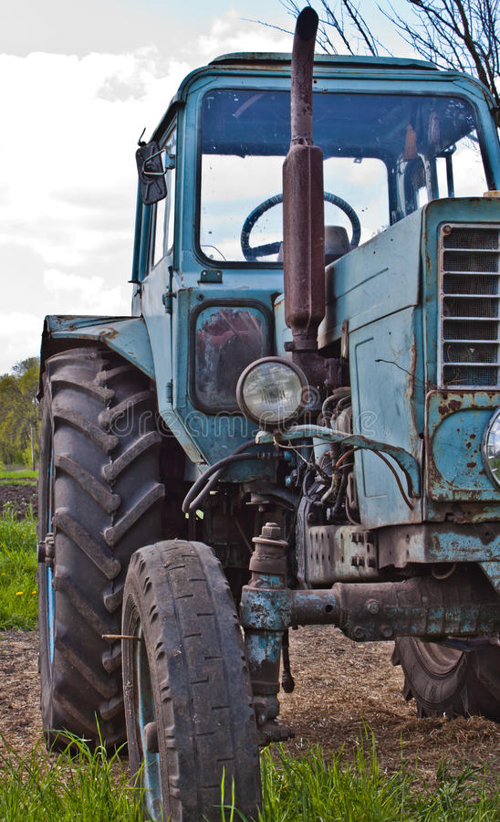 Tractor. Old tractor in summer on field stock photos