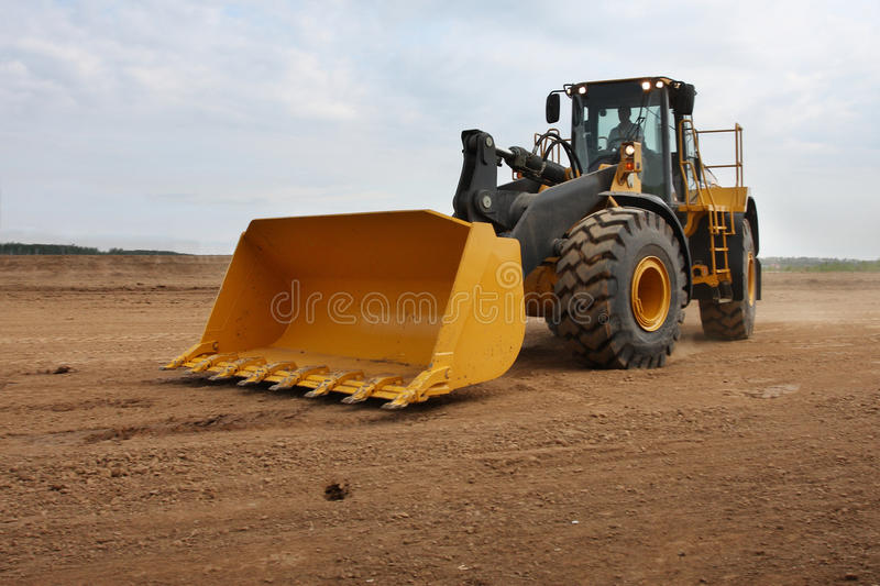 Tractor. The image of working tractor stock image