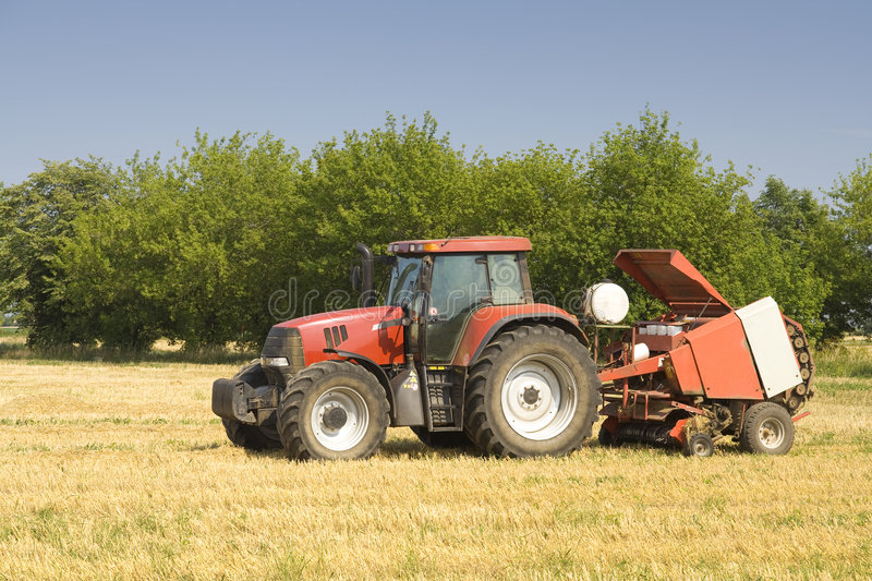 Tractor. On the field with straw stock photos