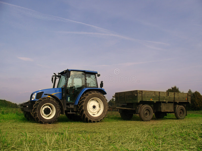 Tractor. On harvest, blue  on field stock photo