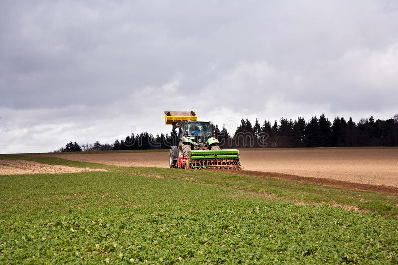 Download Tractor on the acre stock image. Image of clouds, farming - 20818369