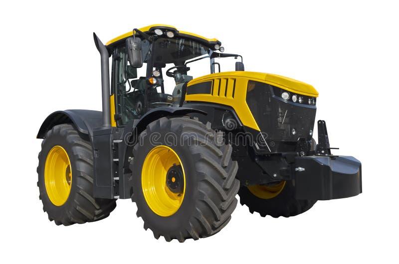 Tractor agrícola amarillo grande, vista delantera foto de archivo