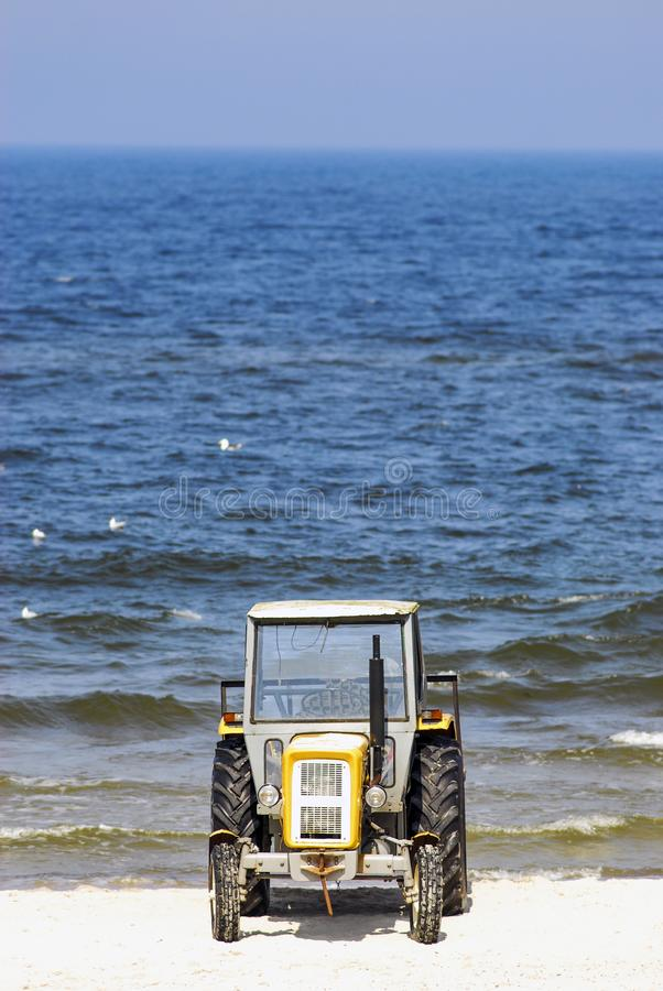 Tractor on the beach, Poland. royalty free stock photo