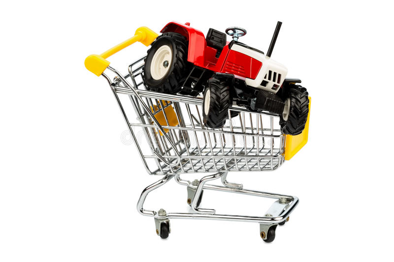Tractor in cart. A tractor in cart symbolizing the purchase of a new agricultural equipment royalty free stock images