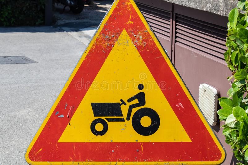 Tractor caution sign, farm vehicle crossing warning sign closeup stock photo