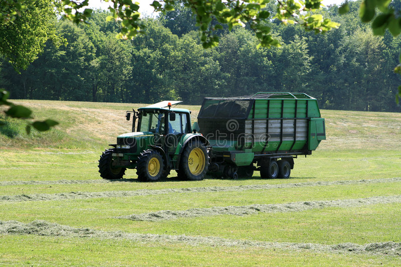 Download Tractor Is Collecting Grass Editorial Photography - Image: 2368862
