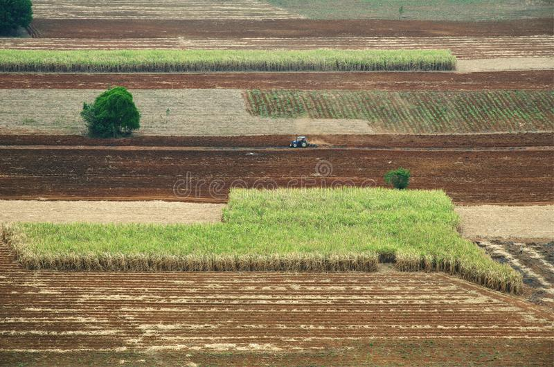 Tractor cultivating field : aerial view royalty free stock photography