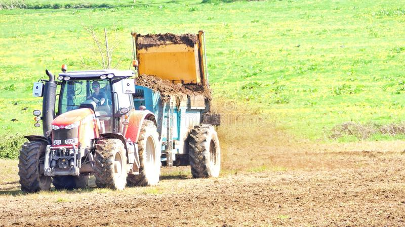 A tractor in Devon, England, getting ready to prepare the soil stock photos