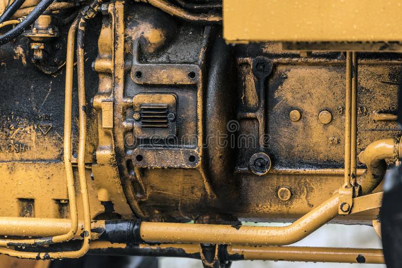 Tractor engine detail. TOrange tractor engine detail closeup royalty free stock photos