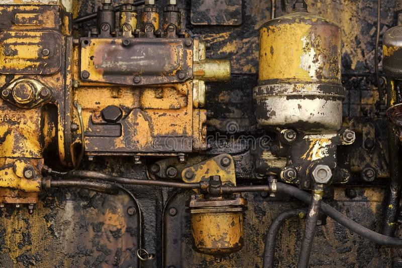 Tractor engine. Machinery with oil dirt on grunge metal background royalty free stock photos