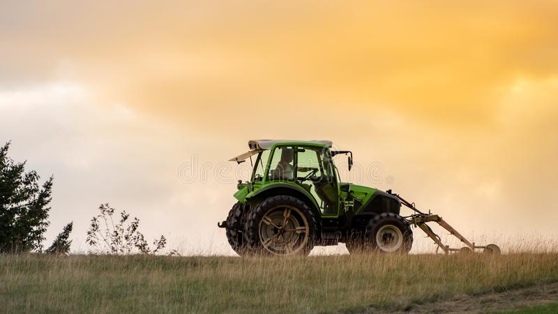 tractor in the evening sky royalty free stock photography