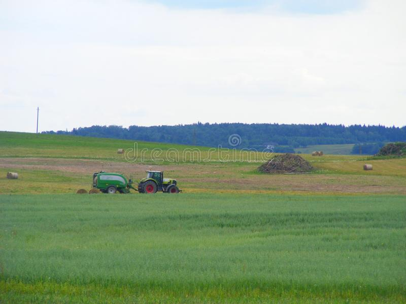Tractor on farm landscape royalty free stock images