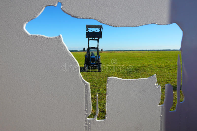 Tractor in a farmer field.Background of agriculture industry stock photography