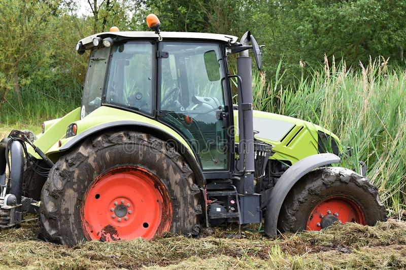 The tractor fell into the swamp. stock photos