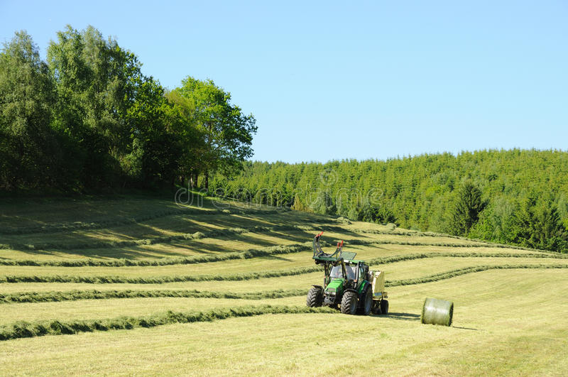 Download Tractor in field stock image. Image of outdoors, meadow - 14656247