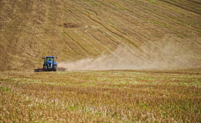 Tractor in a field royalty free stock image