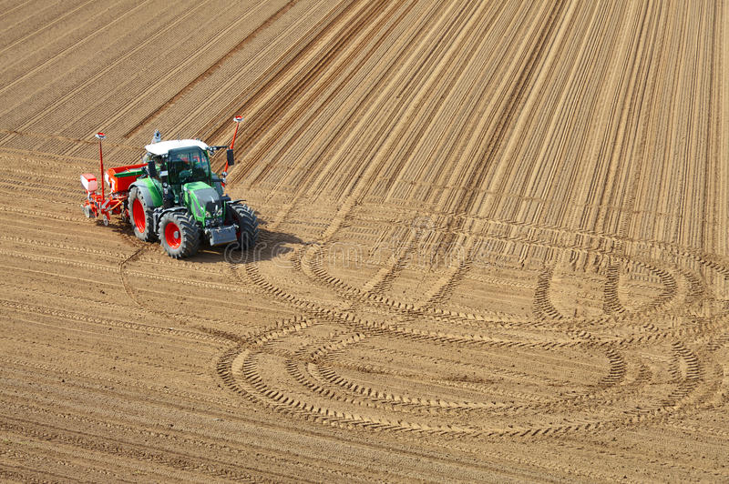 Tractor in aerial view in the field stock photos