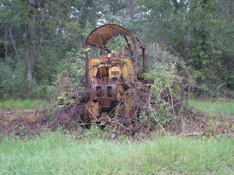 Tractor grown over abandon lost bulldozer nature rusty royalty free stock photography