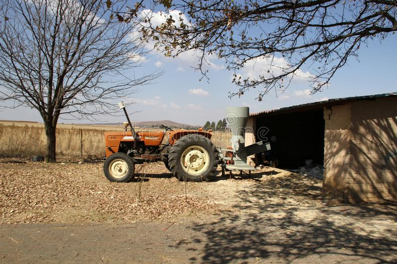 Winter on the farm in the Northwest, South Africa. Tractor and hammer mill at an old farm store royalty free stock photos