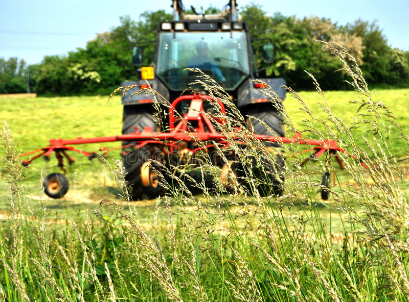 Tractor-haymaking. Industries agriculture grass royalty free stock photos