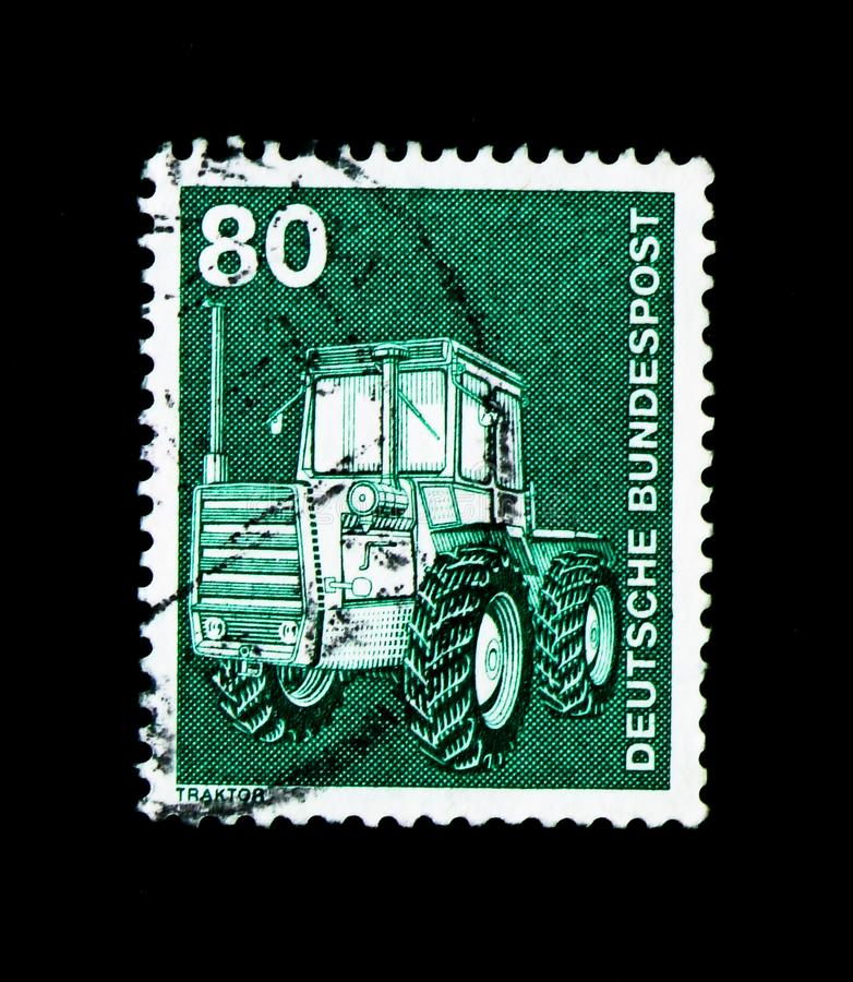 Tractor, Industry and Technology Definitives 1975-1982 serie, ci. MOSCOW, RUSSIA - MARCH 28, 2018: A stamp printed in German Federal Republic shows Tractor royalty free stock image
