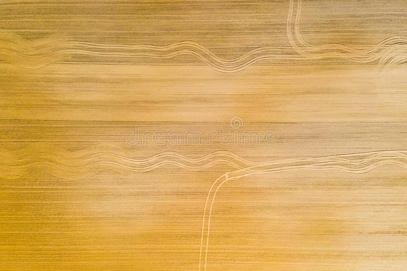 Tractor left track patterns after ploughing farmlands, aerial landscape. Agriculture concept. Tractor left track patterns after ploughing farmlands, aerial royalty free stock photo