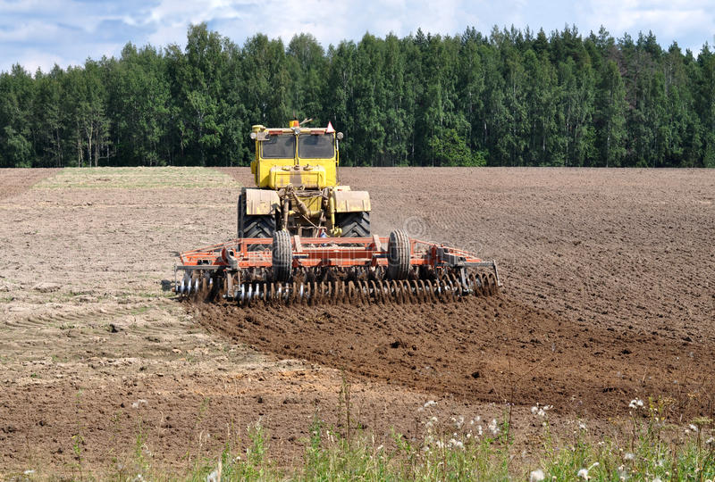 Download The tractor loosens ground stock photo. Image of village - 26035218