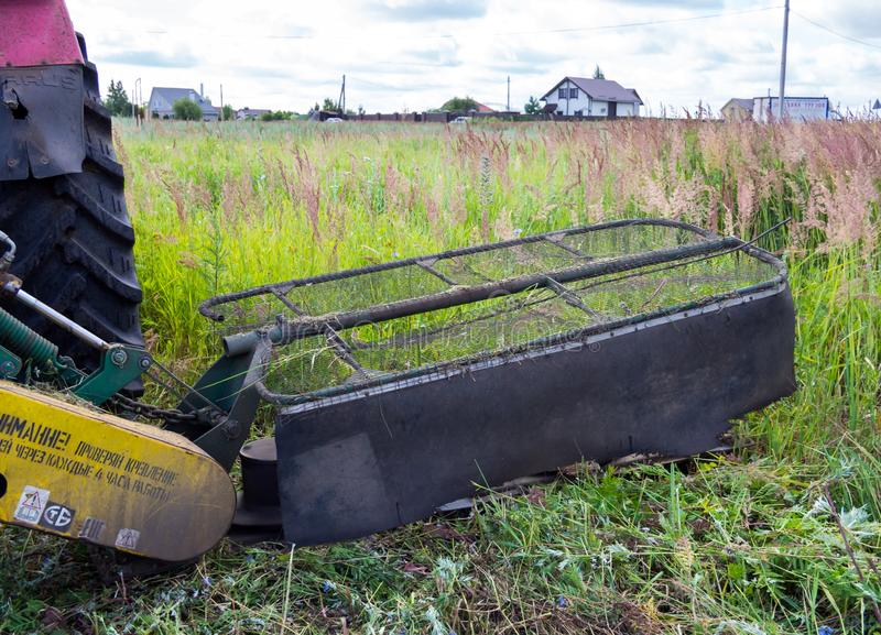 Tractor mounted mower. Voronezh, Russia - July 05, 2018: Tractor mounted mower royalty free stock photos