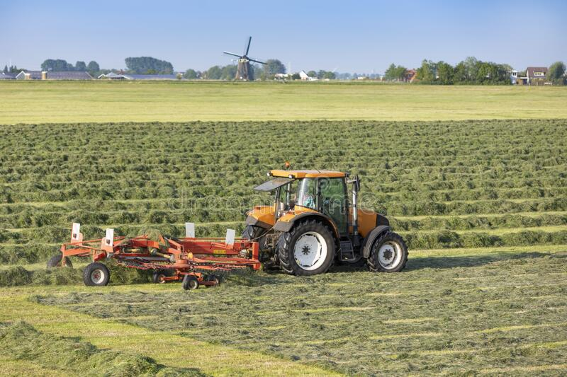 A tractor with a mower in Sassenheim stock photography