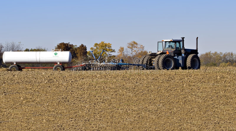 Download Tractor and Plow stock photo. Image of tank, soil, country - 3568148